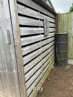 Pressure Treated / tanalised lined wooden apex shed & built in log store custom