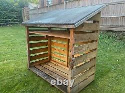 Wooden log store supplied with kiln dried hardwood 25cm logs