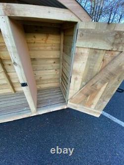 Wooden log store with curved roof and lockable door (brand new)